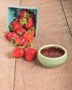 Fresh strawberries and homemade preserves or jelly Royalty Free Stock Photography