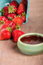 Fresh strawberries and homemade preserves or jelly Stock Images