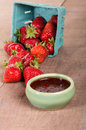 Fresh strawberries and homemade preserves or jelly Royalty Free Stock Photos
