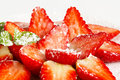 Fresh strawberries with icing sugar halved sprinkled Royalty Free Stock Photos