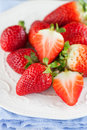 Fresh strawberries juicy in a white bowl on a table selective focus Stock Photos