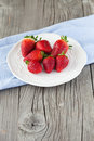 Fresh strawberries juicy in a white bowl on a wooden background selective focus Royalty Free Stock Photos