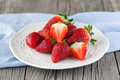 Fresh strawberries juicy in a white bowl on a wooden background selective focus Stock Photography