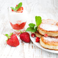 Fresh strawberries pancakes and yogurt delicious brunch with Royalty Free Stock Image