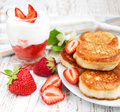 Fresh strawberries pancakes and yogurt delicious brunch with Royalty Free Stock Photo