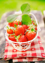 Fresh strawberries in small white basket Stock Photography