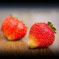 Fresh strawberries strawberry lying on a wooden table macro photo Stock Photography