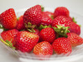 Fresh strawberries were placed in plate on a white background Royalty Free Stock Image