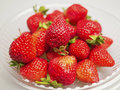 Fresh strawberries were placed in plate on a white background Royalty Free Stock Photography