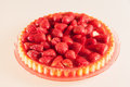 Fresh strawberry cake tart on a glass plate on white Stock Photo