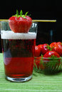 Fresh strawberry drink, radler fruit beer with white foam head Royalty Free Stock Photo