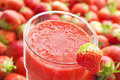 Fresh strawberry smoothie with fruits in the background Stock Images