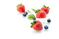 Fresh strawberry in white spoon healthy natural mint blueber diet blueberry Stock Photo