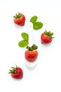 Fresh strawberry in white spoon healthy natural mint diet Stock Photos
