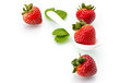 Fresh strawberry in white spoon healthy natural mint diet Royalty Free Stock Photo