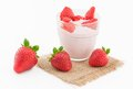 Fresh strawberry with yogurt in a glass isolated Royalty Free Stock Photo