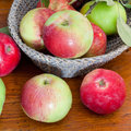 Fresh summer apples on wooden table red and green in basket close up Stock Photography