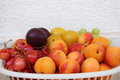 Fresh summer fruits a mix of delicious in a basket on white Royalty Free Stock Photos