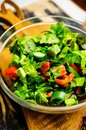 Fresh summer salad with tomatoes lettuce mangold leaves spring onion cucumbers and bellpeppers Stock Photo