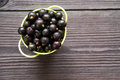 Fresh sweet blackcurrants in the bowl on wooden background Royalty Free Stock Photo