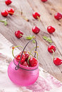 Fresh sweet cherries on wooden background Royalty Free Stock Photo