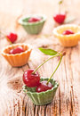 Fresh sweet cherries on wooden background Royalty Free Stock Photos
