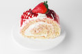 Fresh and sweet strawberry cake on white plate Stock Photos
