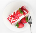 Fresh and sweet strawberry cake on white plate with fork Royalty Free Stock Images
