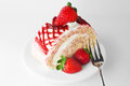 Fresh and sweet strawberry cake on white plate with fork Stock Photos