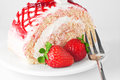 Fresh and sweet strawberry cake on white plate with fork Royalty Free Stock Photo