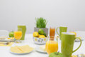 Fresh tasty breakfast in bright colors table setting with Stock Photos
