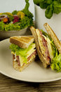Fresh tasty club sandwich with cheese and ham on table Royalty Free Stock Image