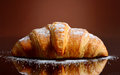Fresh and tasty croissant with butter Stock Photos