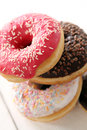 Fresh tasty donuts with different glaze on a white table Royalty Free Stock Images