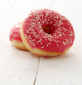 Fresh tasty donuts with glaze on a white table Royalty Free Stock Photo