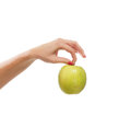 A fresh and tasty green apple held in a beaututiful female hand the image is isoalted on a white background Stock Photography