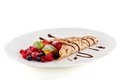 Fresh tasty homemade crepe pancake chocolate sauce fruits berries Royalty Free Stock Photo