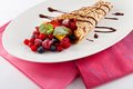 Fresh tasty homemade crepe pancake chocolate sauce fruits berries Royalty Free Stock Photos
