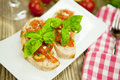 Fresh tasty italian bruschetta with tomato on table Royalty Free Stock Images