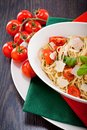 Fresh tasty pasta spaghetti tomatoes parmesan basil table Royalty Free Stock Images