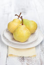 Fresh and tasty pears juicy on a white wooden table Royalty Free Stock Images