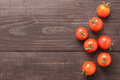 Fresh tomato on the brown wooden background. Top view Royalty Free Stock Photo