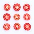 Fresh tomato cut half isolated on white background. Royalty Free Stock Photo