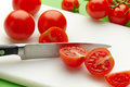 Fresh tomato on cutting board Royalty Free Stock Photo