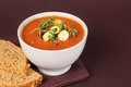Fresh tomato soup with croutons and herbs delicious gourmet pepper bread oregano tomatoes on the side Royalty Free Stock Photography