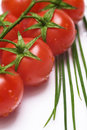 Fresh tomatoes and chive Royalty Free Stock Photos