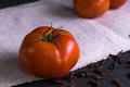 Fresh tomatoes and cloves.