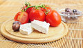 Fresh tomatoes, olives and white cheese Royalty Free Stock Photo