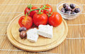 Fresh tomatoes, olives and whote cheese Stock Photography