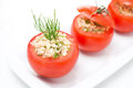Fresh tomatoes stuffed with tuna salad and bulgur on the plate close up Royalty Free Stock Image